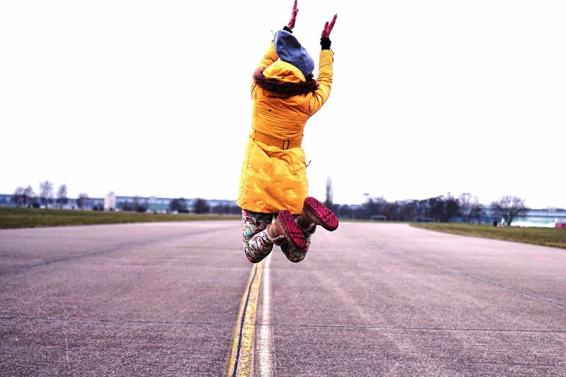 Woman jumping on road