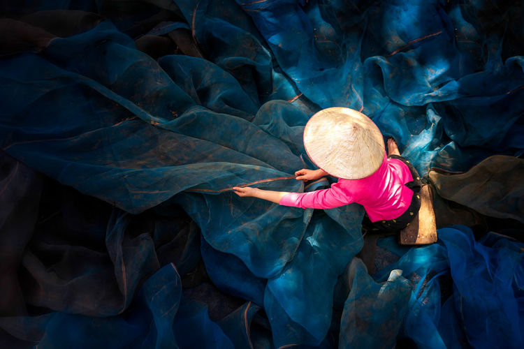 High angle view of woman holding fishing net