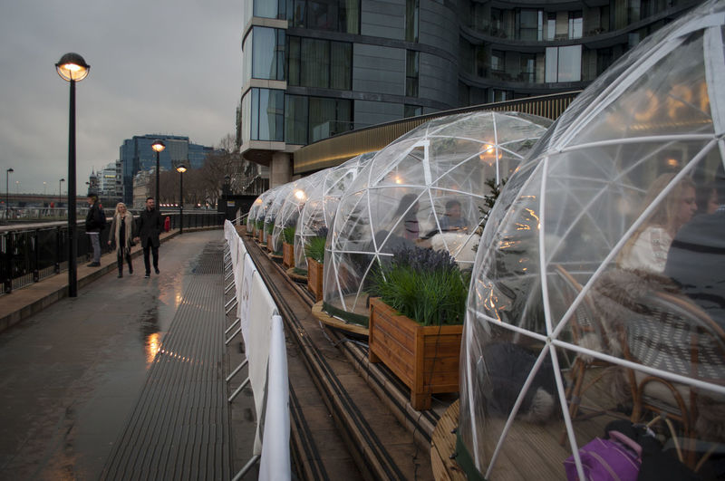 Paradise Pods at Coppa Club, London, England. Eating London Thames River Tower Bridge  Tower Of London Weather Protection Architecture Building Exterior Built Structure City Coppa Club Cosy England Evening Food Incidental People Paradise Pods Plastic Pods Reflection Restaurant Restaurant Terrace Street Tourism Travel Destinations