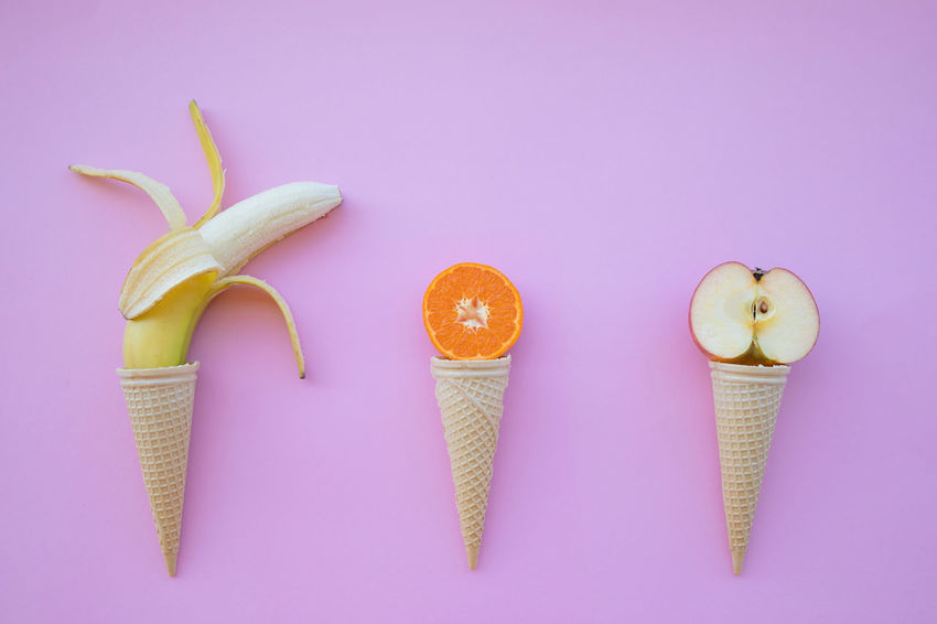 Banana Close-up Colored Background Cone Cut Out Directly Above Food Food And Drink Freshness Fruit Group Of Objects Healthy Eating High Angle View Horn Ice Cream Indoors  No People Orange Pink Background Pink Color Still Life Studio Shot Table Wellbeing