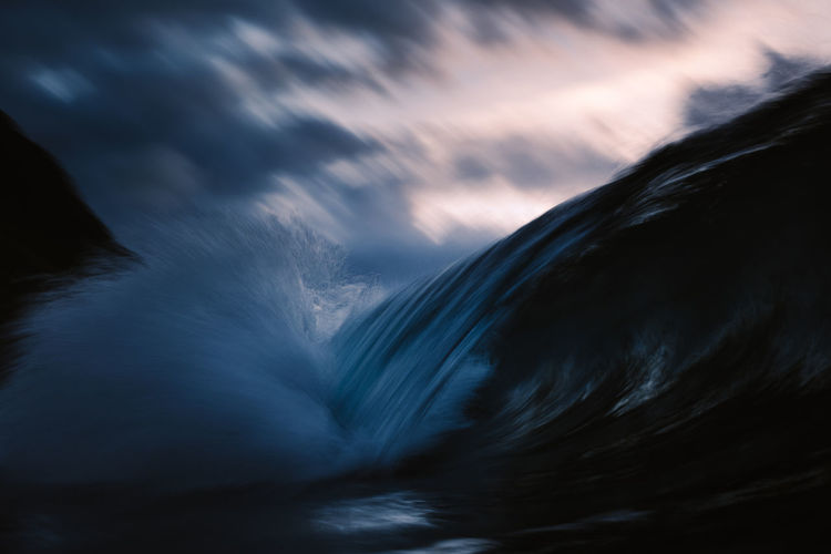Close-up of waterfall against sky during sunset