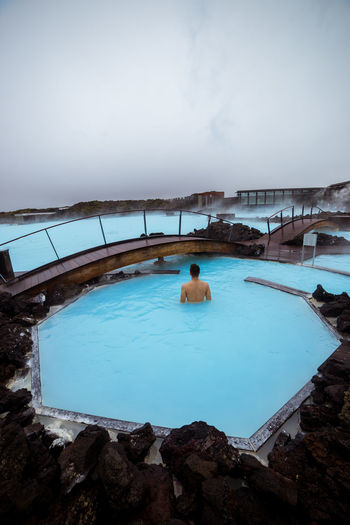 Soaking in the famous Blue Lagoon Grindavik Iceland Architecture Beauty In Nature Bluelagoon Built Structure Cold Temperature Day High Angle View Hot Spring Icelandic Lifestyles Luxury Nature Outdoors Pool Real People Relaxation Scenics - Nature Sky Spa Swimming Swimming Pool Water Winter The Traveler - 2018 EyeEm Awards