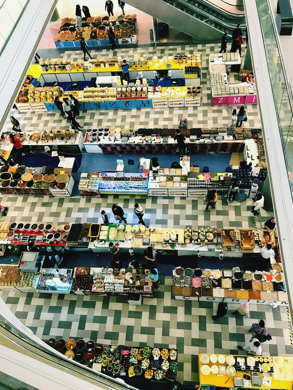 HIGH ANGLE VIEW OF GROUP OF PEOPLE IN SHOPPING MALL