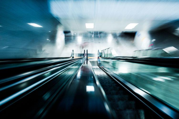 Blurred motion of illuminated escalator