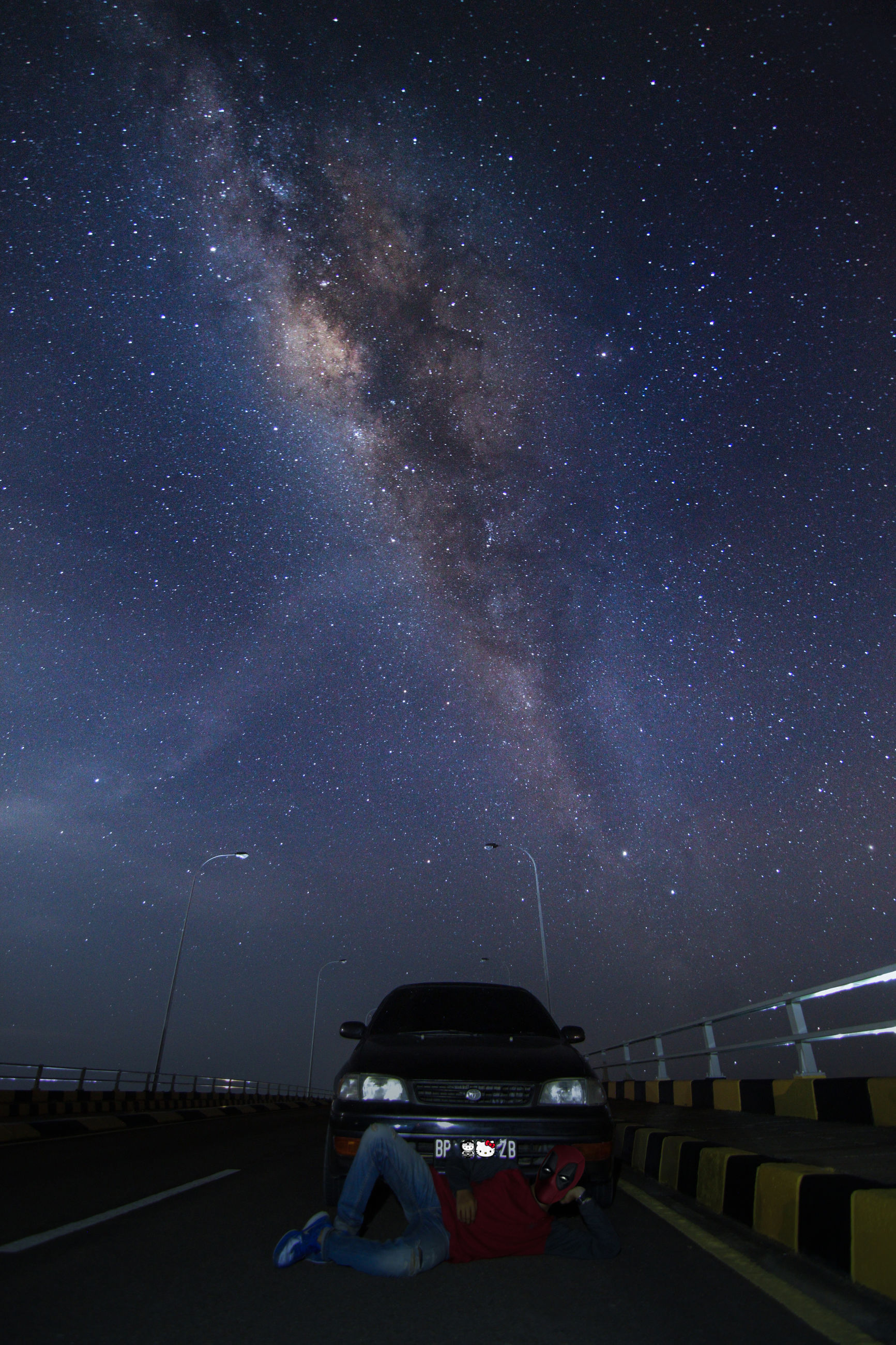 star - space, transportation, night, space, land vehicle, mode of transportation, sky, car, astronomy, star field, motor vehicle, scenics - nature, star, galaxy, nature, road, beauty in nature, one person, infinity, real people, outdoors, milky way