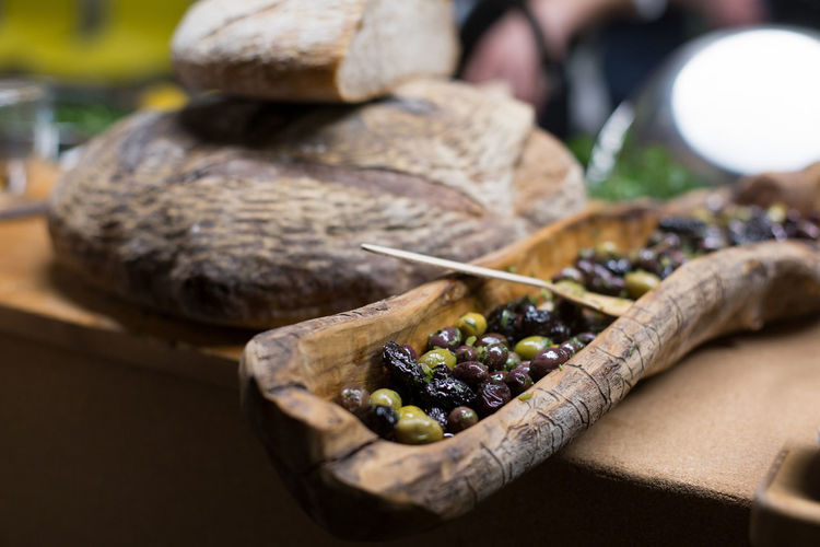 High angle view of olives on wood