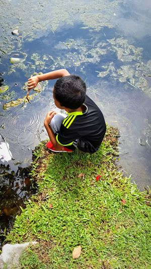 A boy playing beside the lake.Lake View One Person Malaysia Photography Malaysia Tasik Titiwangsa High Angle View Boy The Week On EyeEm