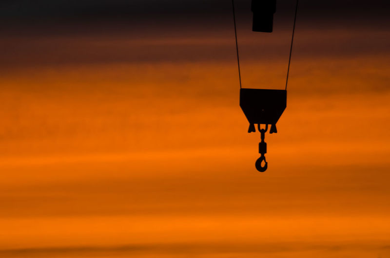 Silhouette Hook Hanging Against Sky During Sunset