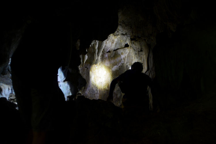 Cave Adventures at the Nature Forest Reserve of Bulabog Puti-an, Dingle, Iloilo, Western Visayas, Philippines. Adventure Cave Caves Dark Darkness And Light Exploring EyeEm Nature Lover EyeEmNewHere Forest Geology Hiking Illuminated Light Natural Nature Nature Nature Photography Naturelovers People Rear View Rock - Object Rock Formation Silhouette Stalagmites Wildlife & Nature The Great Outdoors - 2017 EyeEm Awards