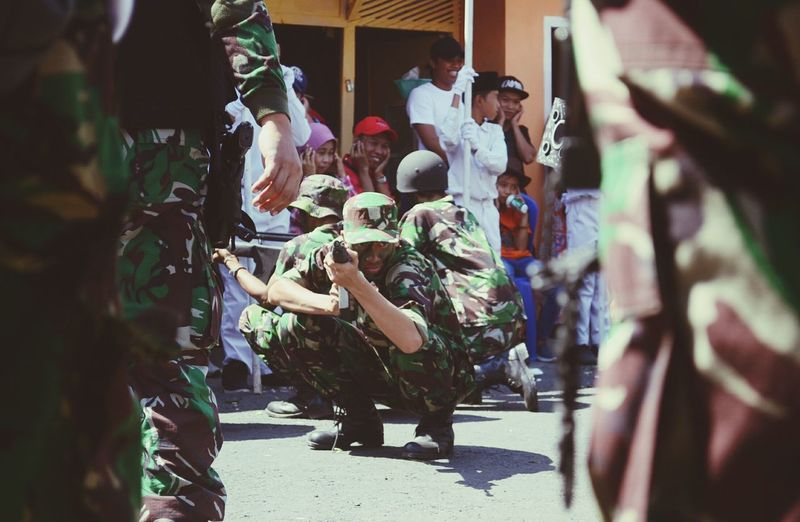 Presented army who destroy all enemy with their gun, they bring a mortar too, you can see people around them close their ears cause the sound of the mortar is so loud. INDONESIA Independence Day Army Soldier Adult People Celebration Togetherness Men Day Child Standing Outdoors Real People Only Men Army The Week On EyeEm