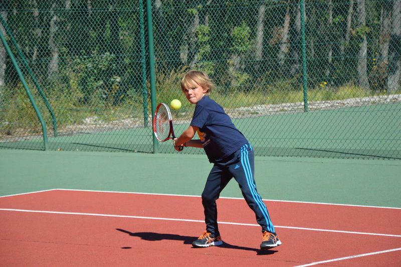 Boy playing with ball in background