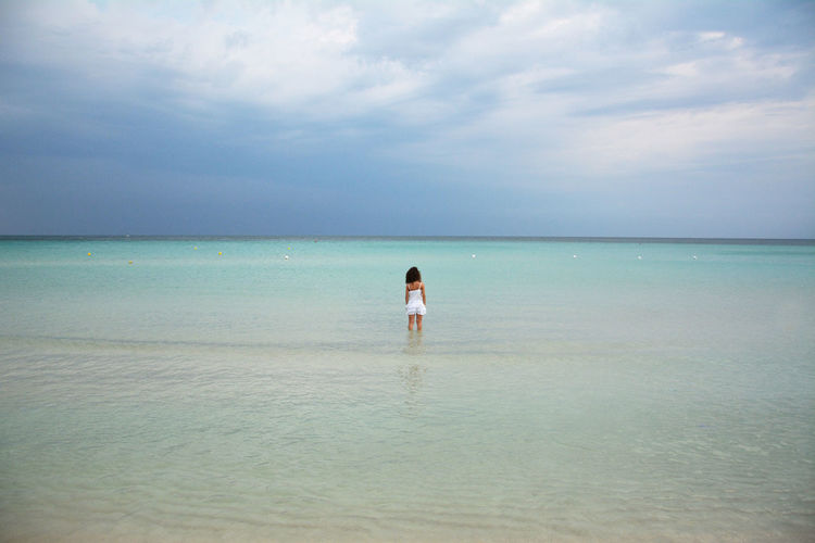 Girl wading in sea