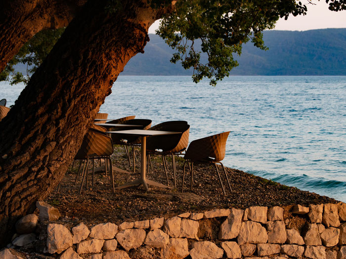 Tranquil view of dining table against sea