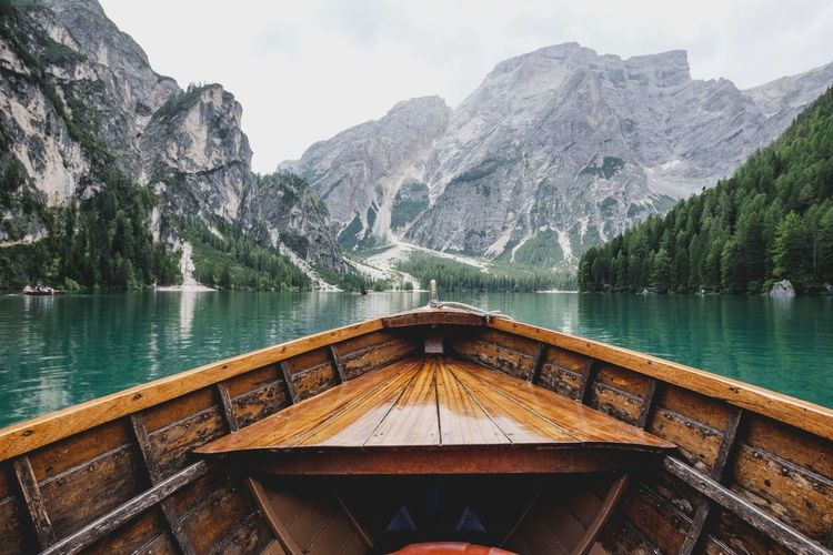 Boat on lake against mountains