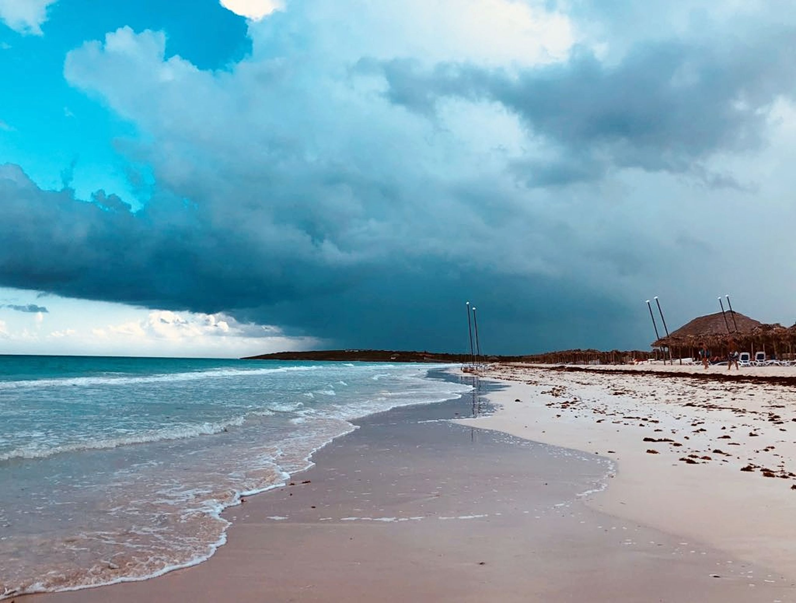 water, cloud - sky, sea, land, beach, sky, beauty in nature, scenics - nature, environment, nature, day, power in nature, wind power, tranquility, power, wind turbine, environmental conservation, tranquil scene, no people, outdoors