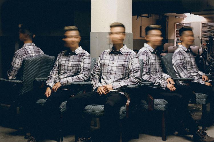 Surreal multiple exposure of man in basement