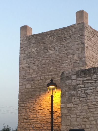 Architecture Built Structure Building Exterior Wall Low Angle View Lighting Equipment Sky The Past History Wall - Building Feature Nature Building Brick Wall Stone Wall Clear Sky Street Light Brick Day Street No People