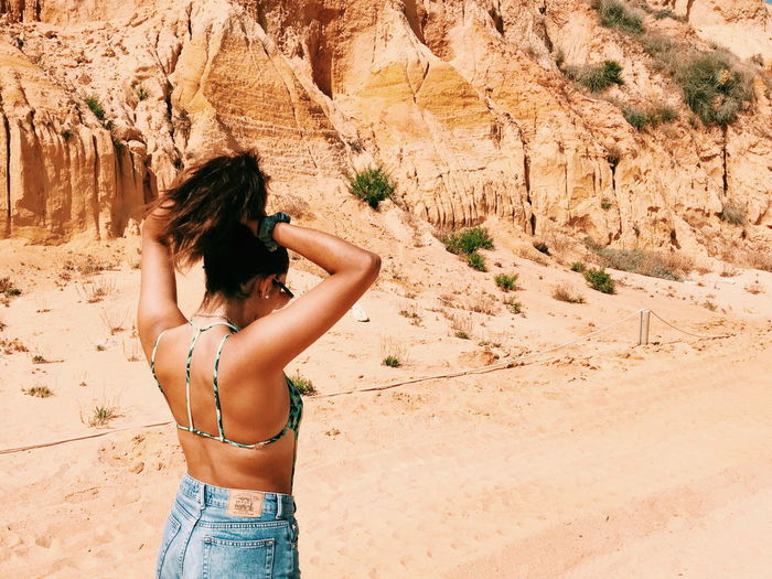 EyeEm Selects Sand One Person Adult Day Summer People Shirtless Desert Standing Leisure Activity One Girl Only Beach Vacations Outdoors Arid Climate Women Young Women Young Adult Nature Human Back Connected By Travel