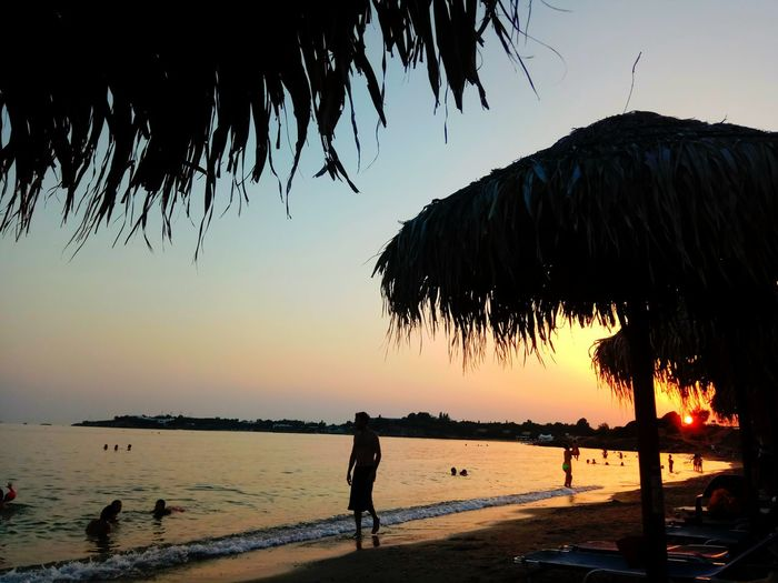 Water Reflection Silhouette Sunset Beach Tranquility Nature Beauty In Nature Tree Sky Outdoors Lake Scenics People Full Length Night Beauty Adult Only Men First Eyeem Photo Lagonisi Beach Greek Summer