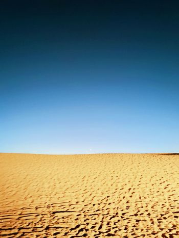 Moon Sand Desert Sand Dune Arid Climate Clear Sky Landscape Outdoors Blue Sunny Summer Horizon Over Land Nature Sky Day Scenics Drought Heat - Temperature Beauty In Nature No People