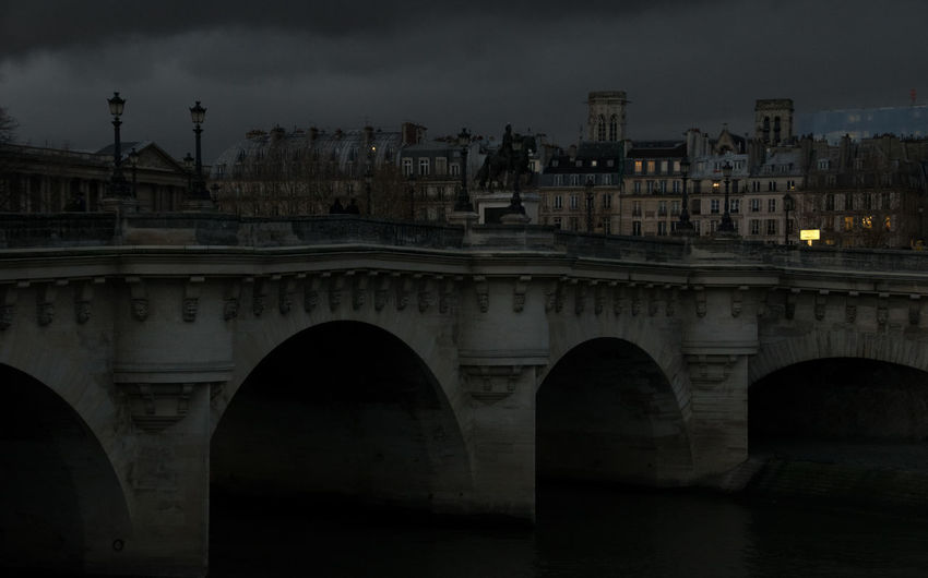 night falls in paris Paris Paris, France  ParisByNight Arch Architecture Bridge Bridge - Man Made Structure Building Exterior Built Structure City Cityscape Cloud - Sky Connection Creepy Night No People River Sky Travel Destinations Travelphotography Water EyeEmNewHere Adventures In The City