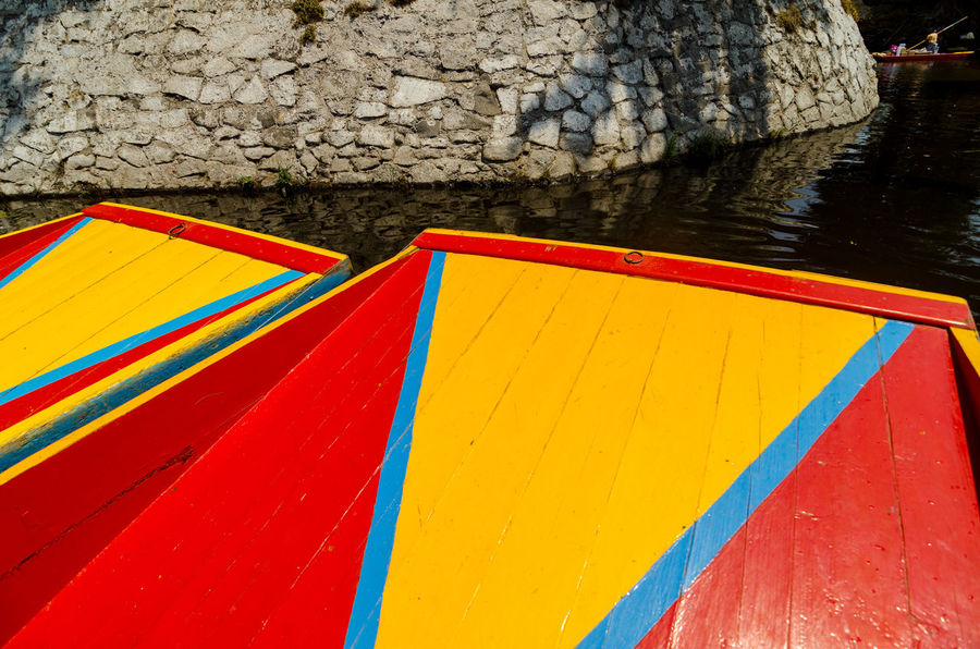 Bright colors of the boats in the Xochimilco Canal in Mexico City Adventure American Boat Boats Bright Canal City Color Colored Colors Culture Ethnicity Flower Garden Hispanic Latin Mexican Ornamental Outdoors River Tourist Traditional Travel Vibrant Xochimilco