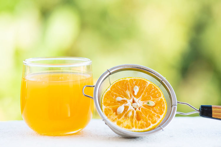Orange juice Food And Drink Healthy Eating Food Drink Refreshment Wellbeing Freshness Yellow Drinking Glass Focus On Foreground Fruit Table Glass Still Life Glass - Material Orange Juice  No People Household Equipment Close-up Transparent Non-alcoholic Beverage Orange Orange Juice  Orange - Fruit