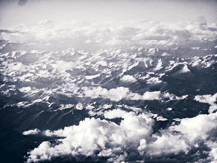 Beauty In Nature Blackandwhite Bluish Cloud - Sky Day From Above  Grain High Contrast Landscape Majestic Monochromatic Monochrome Mountains Mountains From The Sky Nature No People Non-urban Scene Outdoors Scenics Sky Snowy Mountains Tranquility White Color Monochrome Photography