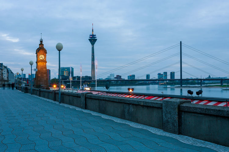 Rhine promenade in Dusseldorf, Germany. Germany Düsseldorf Düsseldorf, Medienhafen City Rhine Tower Rhine Built Structure Architecture Bridge Bridge - Man Made Structure Building Exterior Connection Sky Transportation Travel Destinations Tourism Water Travel Illuminated Tower Nature River Dusk Tall - High No People Outdoors