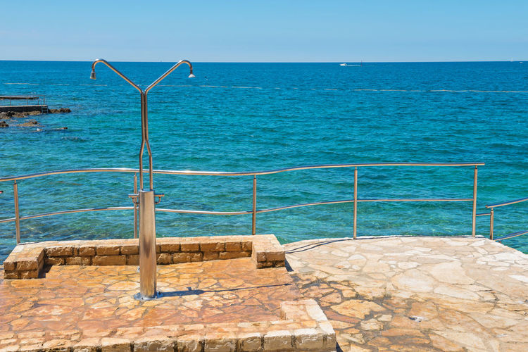 Shower on the rocky beach in Istria, Croatian coast Croatia Beauty In Nature Blue Clear Sky Day Horizon Horizon Over Water Idyllic Nature No People Outdoors Pool Railing Scenics - Nature Sea Sky Sunlight Swimming Pool Tranquil Scene Tranquility Turquoise Colored Water