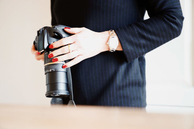 Photography Camera Camera - Photographic Equipment Human Hands Human Body Part Midsection Red Nails One Person Indoors  Standing Holding Technology Real People Black Color Hand Adult Human Hand Occupation Front View Close-up Men Lifestyles Women Business Person Woman Portrait