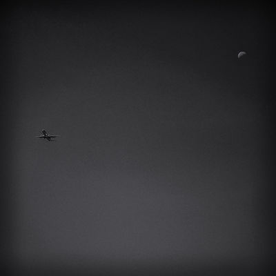 Flying to the moon (and back) Black & White Dark Square Air Vehicle Airplane Black And White Black And White Photography Black&white Blackandwhite Blackandwhite Photography Blackandwhitephotography Clear Sky Day Flying Minimal Mode Of Transport Moon Surface Nature No People Squarecrop Transportation