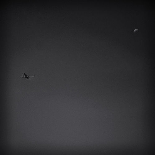 Airplane flying against clear sky