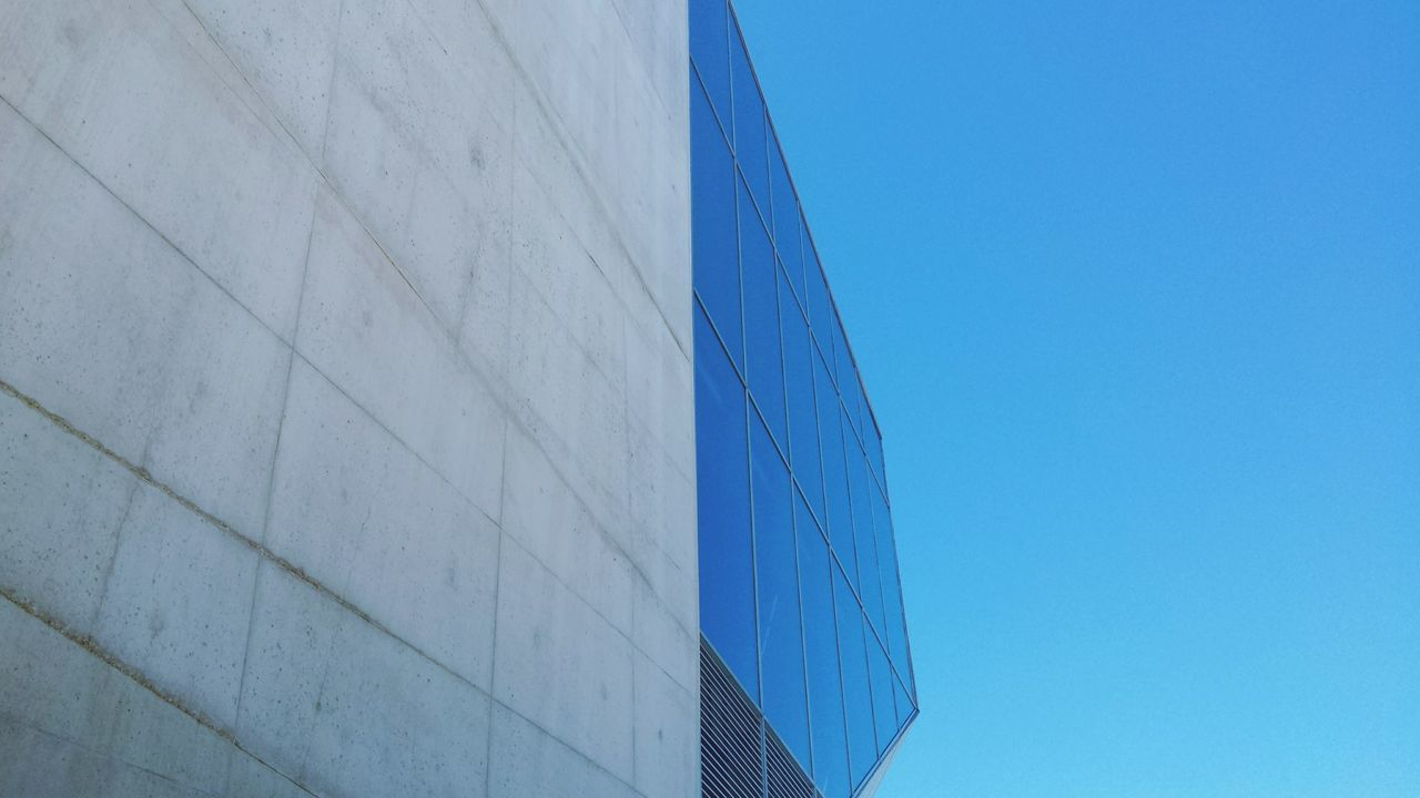 architecture, built structure, building exterior, blue, modern, copy space, outdoors, no people, day, low angle view, clear sky, city, sky