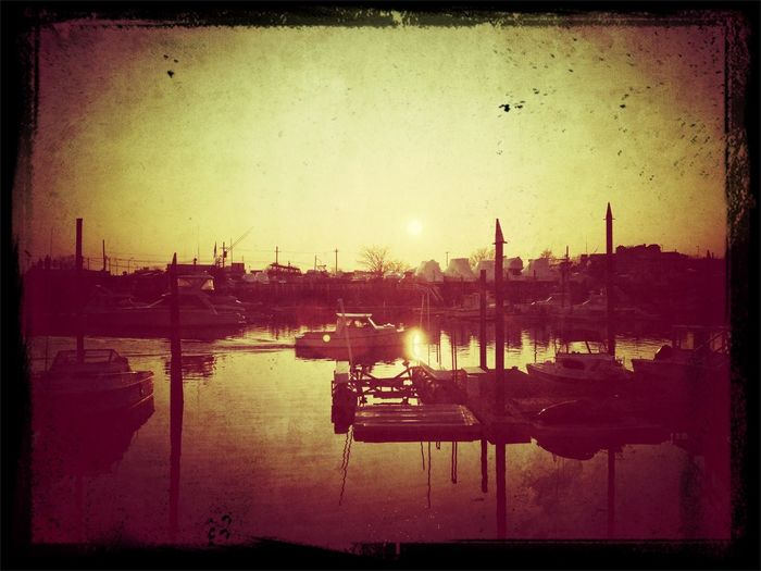 Sunset vintage boat sepia