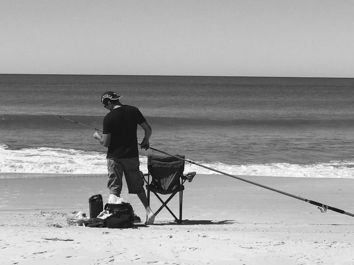 Fisherman Sea Beach Horizon Over Water Water Sand Real People Nature Men One Person Standing Beauty In Nature Full Length Lifestyles Only Men Outdoors Scenics One Man Only Clear Sky Wave Adult Modern Workplace Culture Modern Workplace Culture #urbanana: The Urban Playground