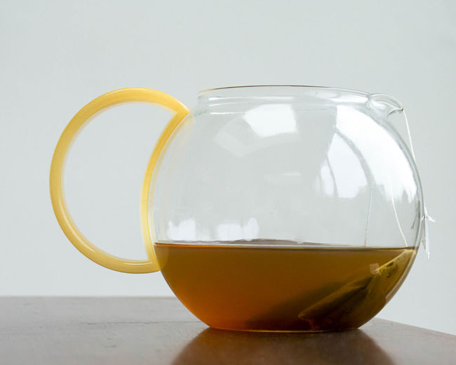 Beverage Close-up Cup Of Tea Day Drink Fish Bowl Freshness Glass Green Tea Handle Healthy Eating Indoors  Natural No People Plastic Pure Purity Refreshments Table Tea Teapot Water White Background Yellow Zen