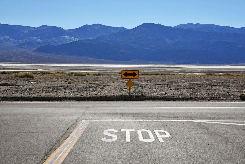 Death Valley, California California Death Valley Road Arrow Symbol Asphalt Dead End Mountain No People Road Sign Stop