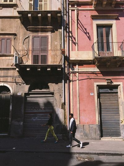 The Street Photographer - 2017 EyeEm Awards Break The Mold Building Exterior Architecture Built Structure Real People Outdoors Full Length Walking Day Men Lifestyles Two People City Adult People Catania Sicily Sicilia