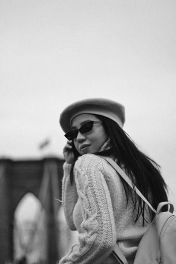 Woman wearing sunglasses against sky