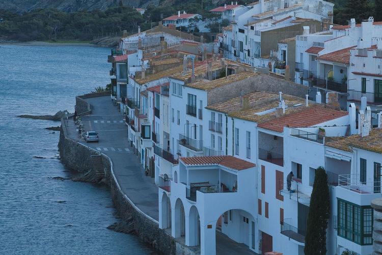 High angle view of townscape by sea riva pitxot cadaquès alt empordà. girona. spain.