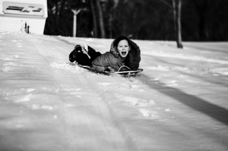 Cheerful Girl Playing In Snow