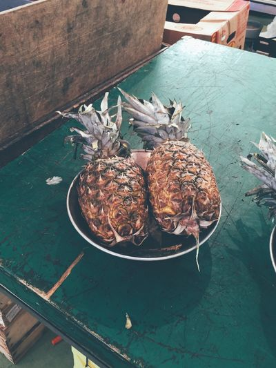 Elevated view of two pineapples on plate