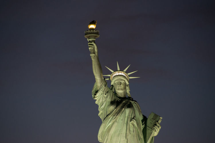 Lit Up NYC New York Statue Of Liberty Boat Trip Female Likeness Flame Flaming Torch Freedom Lady Liberty Low Angle View New York Harbor Sculpture Shining Beacon Sky Statue Tourism Travel Destinations