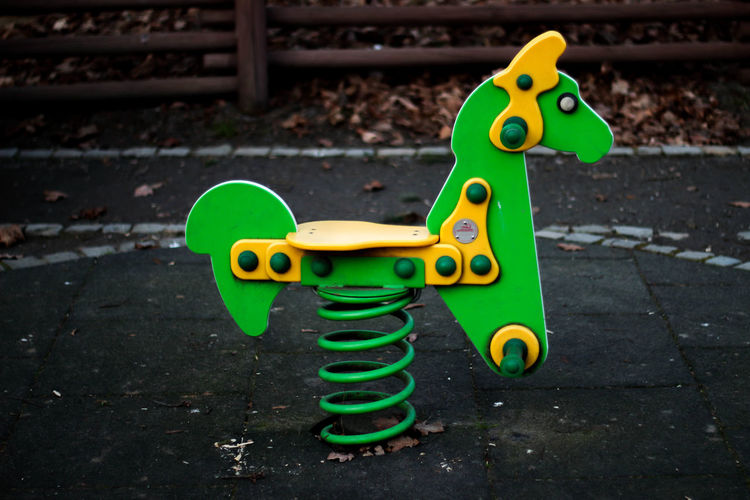 Childhood Close-up Day Green Color Multi Colored No People Outdoor Play Equipment Outdoors Playground Toy Yellow