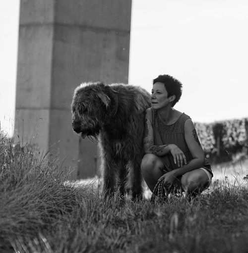 Portrait of woman with irish wolfhound