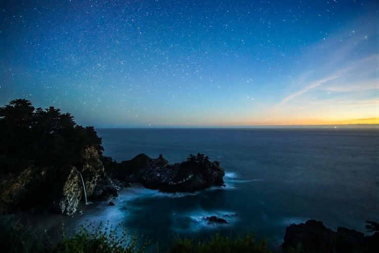 Mcway Falls In Big Sur Against Star Field During Sunset