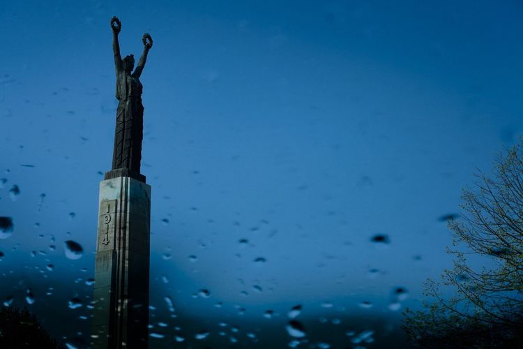 Antwerpen Victory Monument Statue Sky No People Nature Day Water Blue Built Structure Architecture Close-up Metal Low Angle View Drop Focus On Foreground Clear Sky Cold Temperature Outdoors Wet Dusk