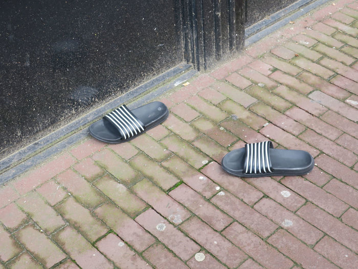 High angle view of shoes on street