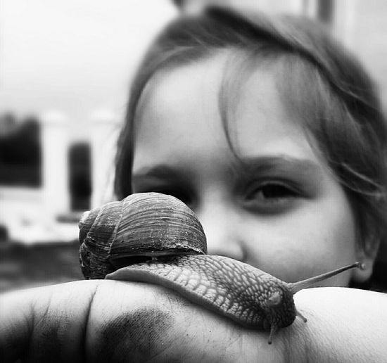 B&W Portrait B&w Photooftheday My Point Of View Blackandwhite Phortrait Snail🐌 Nature_collection Child Reptile One Animal Childhood One Person Headshot People Close-up Children Only Human Hand Day